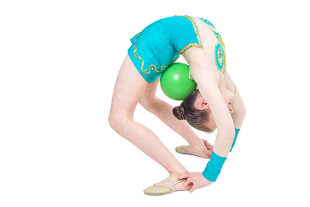 flexibility: Little girl gymnast with green ball. Isolated on white background. Sporting exercise, stretch, flexibility, aerobics