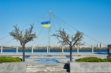 dniper: The Ukrainian flag against the Dnepropetrovsk river Dniper