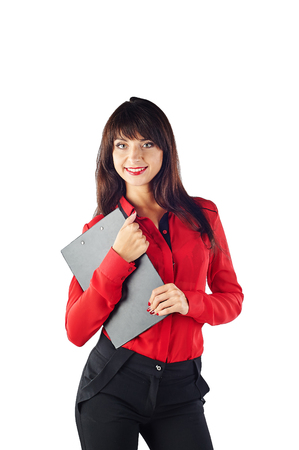 Young beautiful Caucasian business woman in red t-shirt holding clipboard. Isolated on white background