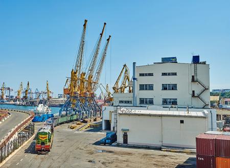 tran: Odessa, Ukraine - August 31, 2015: Tran and cranes in seaport of Odessa, Ukraine