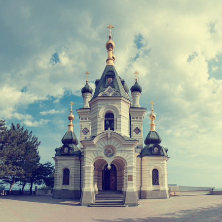 Orthodox church in Foros with sky and clouds. Toned. Stock Photo