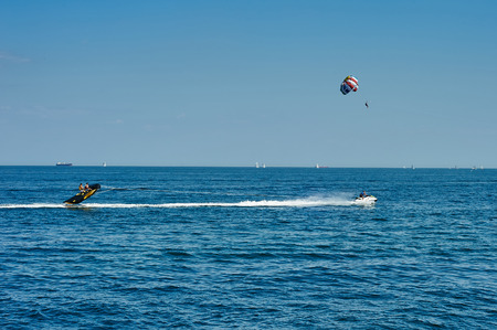 Odessa, Ukraine - August 31, 2015: Parachute on the high seas pulls watercraft on the sea. Parachute on the high. Parachute Editorial
