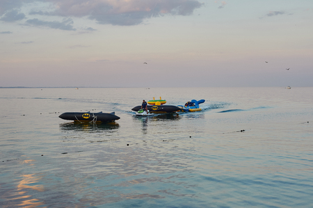 watercraft: Odessa, Ukraine - AUGUST 31, 2015: The hydrocycle tows the inflatable watercraft banana. A sea attraction driving on banana