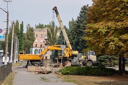 mobile crane: Krivoy Rog, Ukraine - September 22, 2015: Loader excavator and mobile crane. Editorial