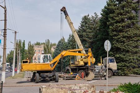 mobile crane: Krivoy Rog, Ukraine - September 22, 2015: Loader excavator and mobile crane