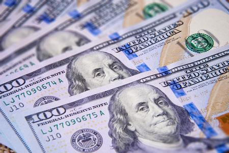 hundred dollar bill: New hundred dollar bills stacked fan. Tilt-shift effect. Stock Photo