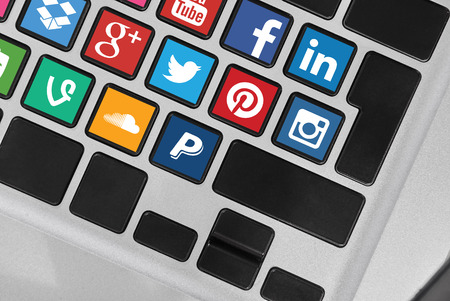 paypal: KRIVOY ROG, UKRAINE - OCTOBER 20, 2015: A social media icons collection placed on computer keyboard.