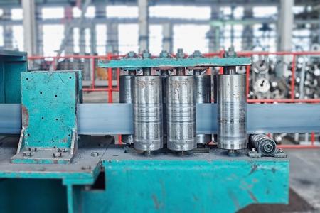 rotates: Rolling mill machine for rolling steel sheet. Tilt shift effect