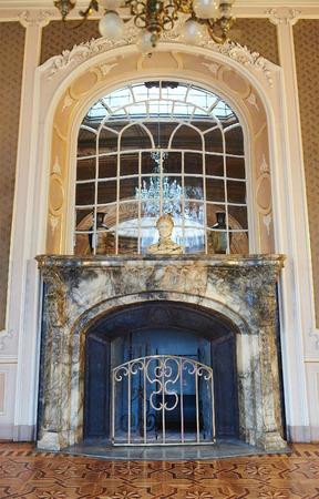 lviv: LVIV, UKRAINE - JANUARY 16, 2016: House of Scientists in Lviv, Ukraine. Vintage marble fireplace. Editorial