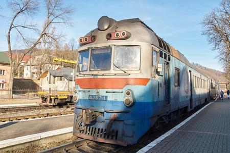 railroad station: YAREMCHE, UKARINE - JANUARY 16, 2016: Old diesel passenger train. Railroad station. Editorial