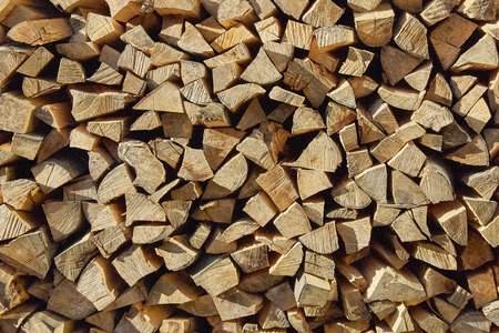 no fires: Background of dry chopped firewood logs in a pile