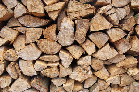 seasoned: Background of dry chopped firewood logs in a pile