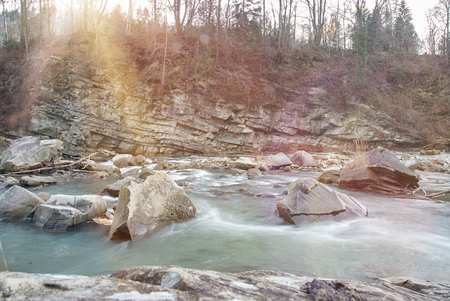 threshold: Threshold of the mountain river. Water stream. Rapid mountain river. Sunny day Stock Photo