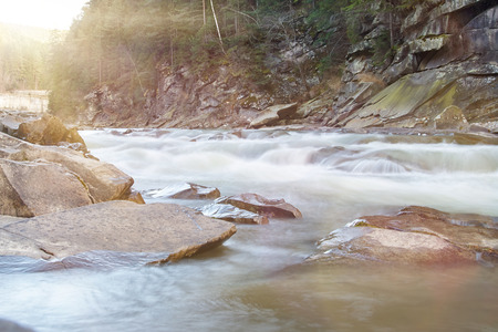 solar flare: Threshold of the mountain river. Water stream. Rapid mountain river. Sunny day. Solar flare Stock Photo