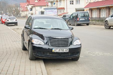chrysler: YAREMCHE, UKRAINE - JANUARY 16, 2016: Black Chrysler PT Cruiser at the rural street. Editorial