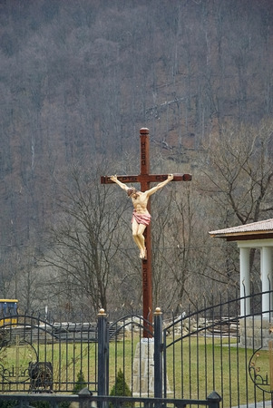 crucify: Christian cross with a crucifix in the church Stock Photo