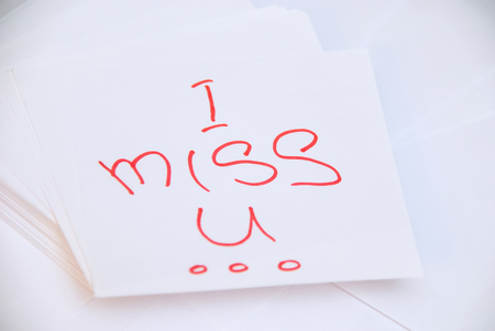 i miss you: White square papers for notes with text i miss you