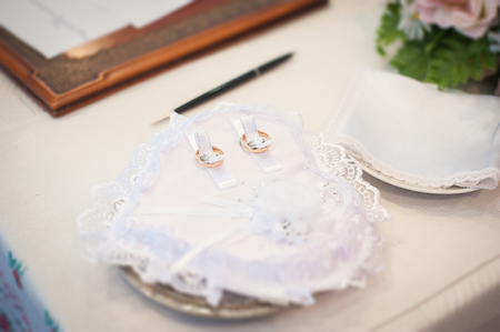 attributes: Wedding rings. Wedding symbols, attributes. Holiday, celebration. Tilt-shift effect