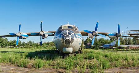 aerodrome: KRIVOY ROG, UKRAINE - FEBRUARY 3, 2016: Panoramic view of old soviet aircraft An-12 Antonov at an abandoned aerodrome