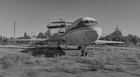 aerodrome: KRIVOY ROG, UKRAINE - FEBRUARY 3, 2016: Old soviet aircraft YAK-42 at an abandoned aerodrome. Black and white image