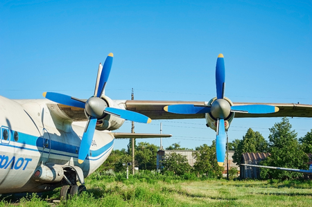turboprop: KRIVOY ROG, UKRAINE - FEBRUARY 5, 2016: Turbines of turboprop old soviet aircraft An-12 at an abandoned aerodrome Editorial