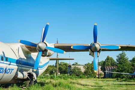 aerodrome: KRIVOY ROG, UKRAINE - FEBRUARY 5, 2016: Turbines of turboprop old soviet aircraft An-12 at an abandoned aerodrome Editorial