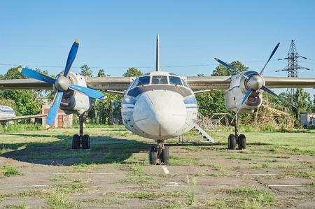 aerodrome: KRIVOY ROG, UKRAINE - FEBRUARY 5, 2016: Panoramic view of old soviet aircraft An-24 Antonov at an abandoned aerodrome