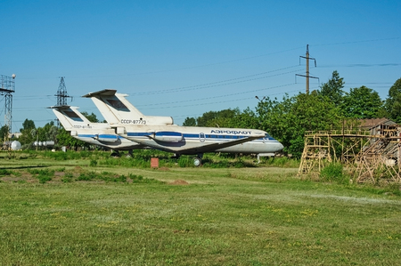 aerodrome: KRIVOY ROG, UKRAINE - FEBRUARY 6, 2016: Two old soviet aircrafts YAK-40 at an abandoned aerodrome. panoramic view on wide angle