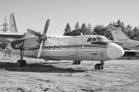 liner transportation: KRIVOY ROG, UKRAINE - FEBRUARY 3, 2016: Panoramic view of old soviet aircraft An-24 Antonov at an abandoned aerodrome. Black and white image Editorial