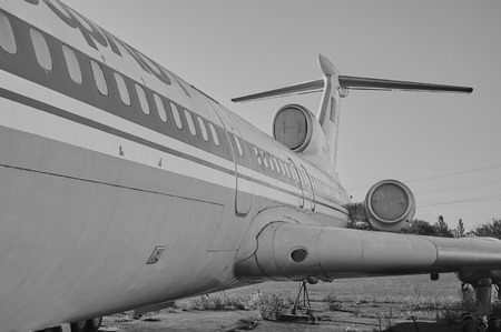 aerodrome: KRIVOY ROG, UKRAINE - FEBRUARY 5, 2016: Panoramic view of old soviet aircraft TU-154 Tupolev at an abandoned aerodrome. Black and white image Editorial