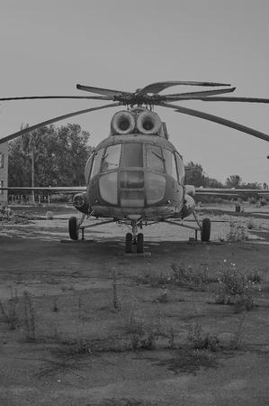 aerodrome: KRIVOY ROG, UKRAINE - FEBRUARY 6, 2016: Old soviet helicopter MI-8 at an abandoned aerodrome. Black and white image Editorial