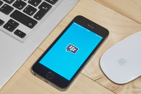 ios: KRIVOY ROG, UKRAINE - FEBRUARY 9, 2016: iPhone 5s with Blackberry messenger app for iOS.