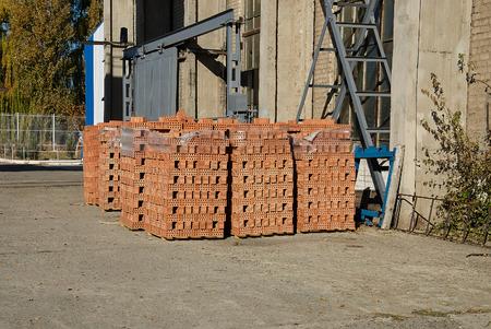 pallete: Stack of red bricks on pallete