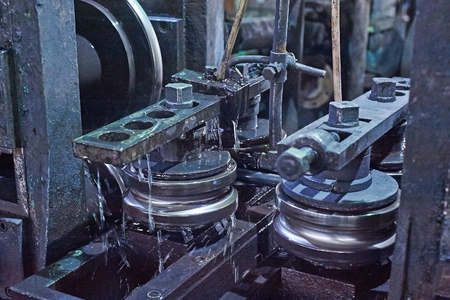 Rolling forming rolls metal works on manufacture of pipes. Rolling mill machine for rolling steel sheet.