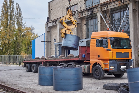unloading: Cranes unloading a freight transport with still rolls Stock Photo