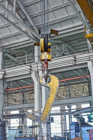 hook up: Close up of a yellow factory crane hook Stock Photo