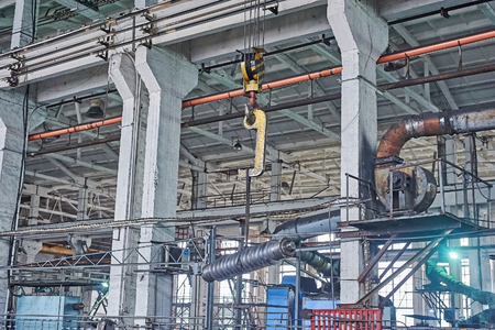 overhead crane: Crane hook transports parts of slitting steel sheet Stock Photo