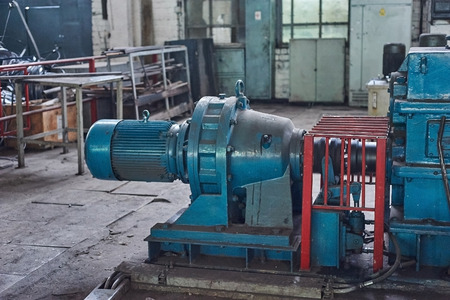 gudgeon: Electric actuator for industrial mill in workshop. Close up. Stock Photo