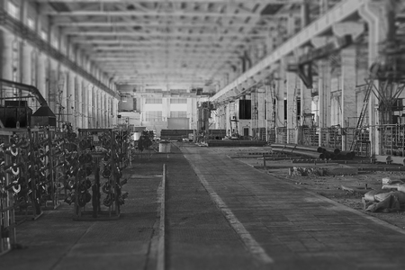 metallurgical: Warehouse with metallurgical material. Steel metal pipes in the package. Black and white image with tilt-shift effect.