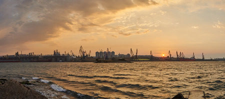 Cargo warehouses in the seaport in sunrise. Panoramic view