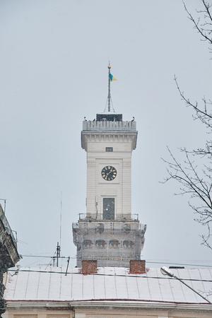 LVIV, UKRAINE - JANUARY 24, 2016: Winter view on Town Hall in Lviv, Ukraine Stock Photo