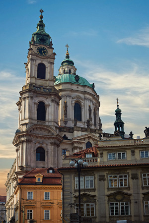 St. Nicholas Church in Prague. Kostel sv. Mikulase. Cathedral in old town. Sunset