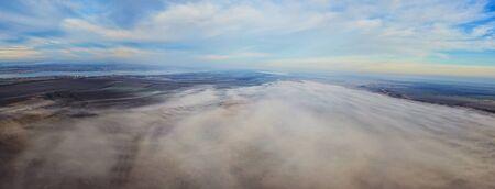 Aerial landscape. Fog above the fields. Bird eye view landscape.
