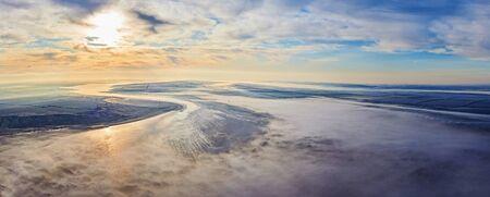 Aerial landscape. Fog above the fields. Bird eye view landscape. Sunrise 免版税图像