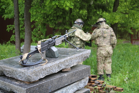 Two soldiers with a machine gun