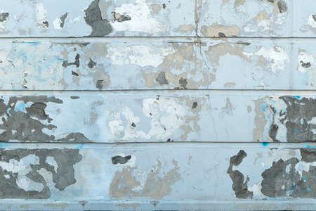 White wall with peeling plaster Standard-Bild