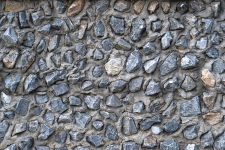 Concrete wall with whole stones Standard-Bild
