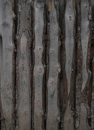 Old natural untreated wood fence