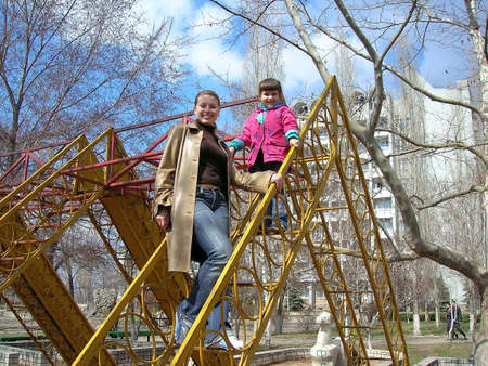 Girls on a ladder photo