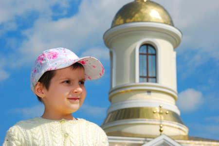 Funny kid on church background   photo